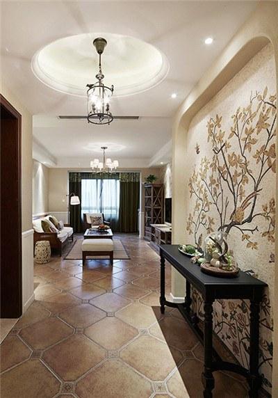 玄关装修效果图 玄关简单的布置加上墙上画的点缀,让进门的人心情