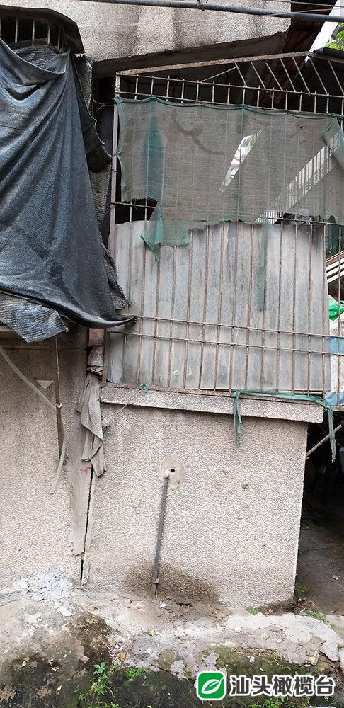 护堤路6号一小区部分墙体沉降开裂,是何原因造成?