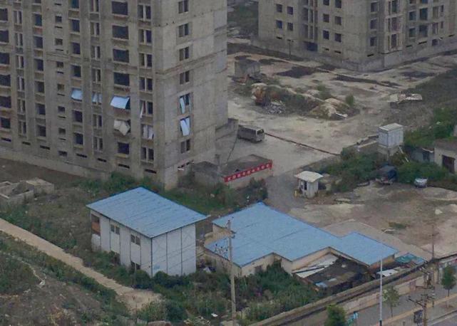 烂尾楼里的 30 位房奴:每天爬 18 楼、一个月洗一次澡搜狐焦点北京站插图(37)